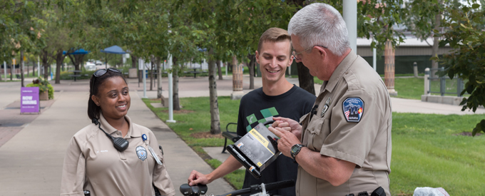 Police talking to student on campus about bike lock
