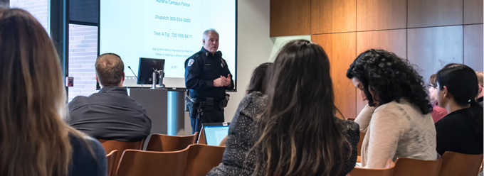 police officer gives a training to employees and students