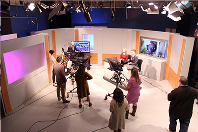 Students from the Met Report use the media center facilities to record their broadcast