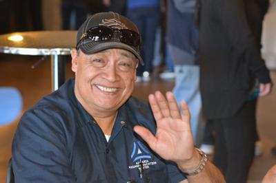 Photo of Carlos Moreno smiling and waving