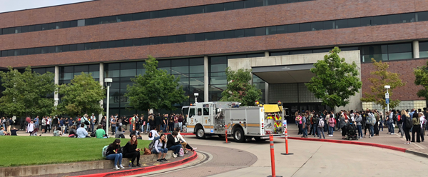 King Center evacuation with fire trucks and students